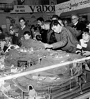 0140957 © Granger - Historical Picture ArchiveENFANTS.   Children playing with electric model train at childhood fair in Paris octobre 30, 1967. Full credit: AGIP - Rue des Archives / Granger, NYC -- All rights reserved.