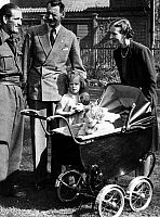 0141379 © Granger - Historical Picture ArchiveFAMILLE ROYALE OF DANEMARK.   Princess Marguerite (Margrethe) of Denmark (future queen Margrethe II), 5 years old, with father king Frederik IX and mother queen Ingrid of Denmark and her sister Benedicte (baby pram, 1 year old) in 1945. Full credit: AGIP - Rue des Archives / Granger, NYC -- All righ