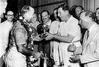 0141441 © Granger - Historical Picture ArchiveFANGIO.   Argentinian president Juan Peron giving the victory cup to racing driver Fangio january 20, 1955. Full credit: AGIP - Rue des Archives / Granger, NYC -- All rights reserv