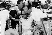 0141442 © Granger - Historical Picture ArchiveFANGIO.   racing driver Fangio after crash during race in Monza june 1952. Full credit: AGIP - Rue des Archives / Granger, NYC -- All Rights Reserved.