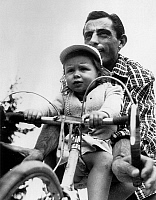 0141508 © Granger - Historical Picture ArchiveFAUSTO COPPI.   Fausto Coppi with daughter Marina riding bike 1949. Full credit: AGIP - Rue des Archives / Granger, NYC -- All Rights Reserved.