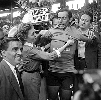 0141518 © Granger - Historical Picture ArchiveFAUSTO COPPI.   Fausto Coppi who won the France cycling race is congratulated by singer Line Renaud july 19, 1952. Full credit: AGIP - Rue des Archives / Granger, NYC -- All rights