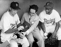 0141526 © Granger - Historical Picture ArchiveFAYCAL II.   king Faycal II of Iraq with american baseballer Charlie Dressen and Jackie Robinson august 20, 1952. Full credit: AGIP - Rue des Archives / Granger, NYC -- All rights