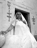 0141598 © Granger - Historical Picture ArchiveFEMME JUIVE OF DJERBA.   Jewish woman in Djerba, Tunisia (on the wall are written the symbols of fertility) 80's. Full credit: AGIP - Rue des Archives / Granger, NYC -- All rights