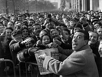 0141686 © Granger - Historical Picture ArchiveFERNANDEL.   The french actor Fernandel (Fernand Joseph Desire Contandin), on the street of Champs Elysees in Paris acclaimed by the crowd during a event for the fight against the cancer, march 16, 1958. Full credit: AGIP - Rue des Archives / Granger, NYC -- All rights reserved.