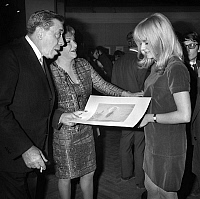 0141699 © Granger - Historical Picture ArchiveFERNANDEL, LINE RENAUD AND SYLVIE VARTAN.   Fernandel, Line Renaud and Sylvie Vartan at auction of children drawings, Paris, december 15, 1966. Full credit: AGIP - Rue des Archives / Granger, NYC -- All rights reserved.