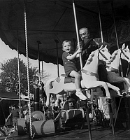 0141774 © Granger - Historical Picture ArchiveFETE FORAINE.   Boy on a merry-go-round at the funfair on april 16, 1949. Full credit: AGIP - Rue des Archives / Granger, NYC -- All Rights Reserved.