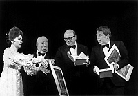 0141947 © Granger - Historical Picture ArchiveFRANCESCO ROSI AND ELIO PETRI.   Cannes film festival on may 22, 1972 : Gina Lollobrigida and Alfred Hitchcock giving the Palme d'or to Francesco Rosi and Elio Petri. Full credit: AGIP - Rue des Archives / Granger, NYC -- All rights reserve