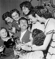 0142033 © Granger - Historical Picture ArchiveFRANCK VILLARD.   French actor Franck Villard with admirers fans, drinking champagne April 25 1955. Full credit: AGIP - Rue des Archives / Granger, NYC -- All rights reserved.