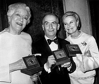 0142395 © Granger - Historical Picture ArchiveFRANCOISE ROSAY, LOUIS OF FUNES AND MICHELE MORGAN.   Nuit du cinema (prize giving ceremony) in Paris on november 29, 1968 : Francoise Rosay, Louis De Funes and Michele Morgan with their prize. Full credit: AGIP - Rue des Archives / Granger, NYC -- All Rights Reserved.