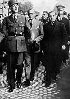 0142790 © Granger - Historical Picture ArchiveGENERAL CHARLES DE GAULLE.   French General De Gaulle and Pierre Mendes France in Havre north of France in october 1944 after the liberation of the city. On r behind, with cap : Claude Gay, De Gaulle's aide-de-camp. Full credit: AGIP - Rue des Archives / Granger, NYC -- All rights reserved.