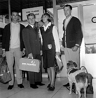 0143021 © Granger - Historical Picture ArchiveGEORGES OF CAUNES.   Athlets Jean Claude Magnan (fencing), Christine Caron (swimming) and Pierre Trentin (cycling) with presenter Georges DeCaunes and his dog at Orly airport before departure september 19, 1964. Full credit: AGIP - Rue des Archives / Granger, NYC -- All rights reserved.