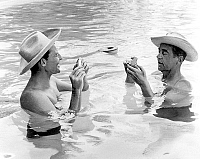 0143467 © Granger - Historical Picture ArchiveGERARD PHILIPE AND JEAN SERVAIS.   Gerard Philipe and Jean Servais playing card in a swimming pool on set of film Fever rises at El Paso july 01, 1959. Full credit: AGIP - Rue des Archives / Granger, NYC -- All rights reserved.