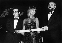 0143776 © Granger - Historical Picture ArchiveGIUSEPPE TORNATORE, JANE FONDA, BERTRAND BLIER.   Cannes film festival : Jane Fonda giving the jury special prize to french director Bertrand Blier for the film Too Beautiful for You and italian director Giuseppe Tornatore for the film Cinema Paradiso, may 26, 1989. Full credit: AGIP - Rue des Archives / Granger, NYC -- All rights reserved.