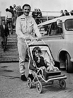 0143903 © Granger - Historical Picture ArchiveGRAHAM HILL.   The racing driver Graham Hill with his daugther Samantha at the circuit of Silverstone, april 1968. Full credit: AGIP - Rue des Archives / Granger, NYC -- All rights