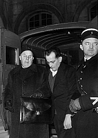 0144251 © Granger - Historical Picture ArchiveGUY DESNOYER AND L'ABBE BRANDIKOUR.   At the french law courts, the father Guy Desnoyers before his verdict for the murder of Regine Fays with Abbe Brandikourt, prison chaplain and a french policeman, january 24, 1958. Full credit: AGIP - Rue des Archives / Granger, NYC -- All rights reserved.