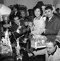 0144549 © Granger - Historical Picture ArchiveHELENE MARTIN.   French singer Helene Martin (with cat) and l-r : Michel Renault, Olivier Hussenot, Andre Gilles, Jacques Esterel on april 10, 1962, all gathered in a acfe of the flea market for the new song Saint Ouen's blues. Full credit: AGIP - Rue des Archives / Granger, NYC -- All rights reserv