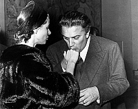 0145248 © Granger - Historical Picture ArchiveINGRID BERGMAN AND FEDERICO FELLINI.   Director Federico Fellini kissing hand of Ingrid Bergman in Rome november 10, 1957. Full credit: AGIP - Rue des Archives / Granger, NYC -- All Rights Reserved.