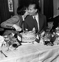 0145255 © Granger - Historical Picture ArchiveBERGMAN & ROSSELLINI, 1951.   Swedish actress Ingrid Bergman cuts the cake and kisses her second husband, Italian film director Roberto Rossellini, at a celebration of his 45th birthday, 8 May 1951. Full credit: AGIP - Rue des Archives / Granger, NYC -- All Rights Reserved.