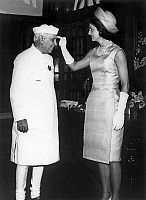 0145523 © Granger - Historical Picture ArchiveJACKIE KENNEDY.   Jackie Kennedy putting some tilak (red paste hindu mark) on the forehead of Nehru march 1962. Full credit: AGIP - Rue des Archives / Granger, NYC -- All rights re