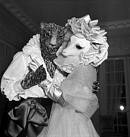 0146104 © Granger - Historical Picture ArchiveJACQUES FATH A UN BAL MASQUE.   French dress designer Jacques Fath (with head of leopard) dancing with his wife Genevieve Boucher de la Bruyere during a fancy dress ball on march 24, 1949. Full credit: AGIP - Rue des Archives / Granger, NYC -- All Rights Reserved.