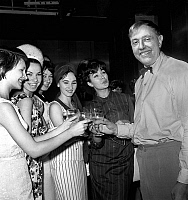 0146278 © Granger - Historical Picture ArchiveJACQUES TATI.   director Jacques Tati with Edith Pierha (1st right) and the girls Moscow Music Hall Girls on set of film Play Time june 26, 1965 trinquer toast. Full credit: AGIP - Rue des Archives / Granger, NYC -- All rights reserved.