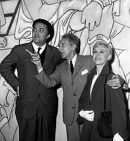 0146696 © Granger - Historical Picture ArchiveJEAN COCTEAU, FREDERICO FELLINI AND SA FEMME.   Jean Cocteau visits with Fellini and his wife Giuliana Masina Villefranche's chapel he had decorated, may 13, 1957. Full credit: AGIP - Rue des Archives / Granger, NYC -- All rights reserved.