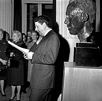 0146715 © Granger - Historical Picture ArchiveJEAN DESAILLY.   French comedian Jean Desailly paying tribute to Albert Camus during ceremony in Theatre de France, Paris, unveiling a bust of the writer in presence of his wife Francine Camus january 11, 1964. Full credit: AGIP - Rue des Archives / Granger, NYC -- All rights reserved.