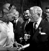 0146757 © Granger - Historical Picture ArchiveJEAN AND DOMINIQUE.   Jean Gabin receiving the Cross of the Legion of Honour, here congratulated by his wife Dominique Fournier february 25, 1960. Full credit: AGIP - Rue des Archives / Granger, NYC -- All rights reserved.