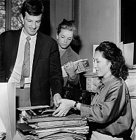 0147146 © Granger - Historical Picture ArchiveJEAN PAUL AND MURIEL BELMONDO.   Jean Paul Belmondo and his sister dancer Muriel Belmondo buying book about dance to Nina Vyroubova in support of Olga Probrajenskaya (to raise funds for her disease) may 06, 1962. Full credit: AGIP - Rue des Archives / Granger, NYC -- All rights reserved.
