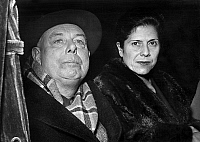 0147309 © Granger - Historical Picture ArchiveJEAN RENOIR AND SA FEMME DIDO.   director Jean Renoir and his wife arriving at Paris after 12 years absence for a film about Van Gogh october 28, 1953. Full credit: AGIP - Rue des Archives / Granger, NYC -- All rights reserved.