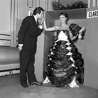 0147342 © Granger - Historical Picture ArchiveJEAN RICHARD AND PIERRETTE BRUNO.   Jean Richard and Pierrette Bruno wearing a dress by Pierre Clarence made with hessian, kitchen foil, gift ribbon, october 28, 1953. Full credit: AGIP - Rue des Archives / Granger, NYC -- All rights reserv