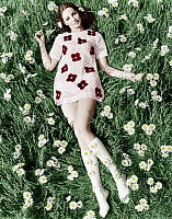 0147725 © Granger - Historical Picture ArchiveJEUNE FEMME AUX MARGUERITES.   Young model Biddy Lampard in the grass wearing a short dress (with daisies) inspired by Courreges august 1967 colorized document. Full credit: AGIP - Rue des Archives / Granger, NYC -- All rights reserved.