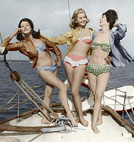 0147734 © Granger - Historical Picture ArchiveFASHION: BIKINIS.   Three young women wearing bikinis, late 1950s or early 1960s. Colorized photograph. Full credit: AGIP - Rue des Archives / Granger, NYC -- All rights reserved.