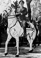 0148343 © Granger - Historical Picture ArchiveJUAN PERON.   Argentinian president Juan Peron during presidential campaign on his favorite horse Criolla especially trained for military parades february 1941. Full credit: AGIP - Rue des Archives / Granger, NYC -- All rights reserved.