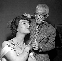 0149956 © Granger - Historical Picture ArchiveLE PEINTRE FOUJITA.   Painter Foujita making Danielle up in Harriet Hubbard Ayer salon, Paris, june 10, 1952. Full credit: AGIP - Rue des Archives / Granger, NYC -- All rights rese