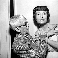 0149957 © Granger - Historical Picture ArchiveLE PEINTRE FOUJITA.   Painter Foujita making Danielle up in Harriet Hubbard Ayer salon, Paris, june 10, 1952. Full credit: AGIP - Rue des Archives / Granger, NYC -- All rights rese