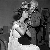 0149958 © Granger - Historical Picture ArchiveLE PEINTRE FOUJITA.   Painter Foujita making Danielle up in Harriet Hubbard Ayer salon, Paris, june 10, 1952. Full credit: AGIP - Rue des Archives / Granger, NYC -- All rights rese