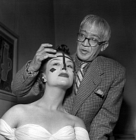 0149959 © Granger - Historical Picture ArchiveLE PEINTRE FOUJITA.   Painter Foujita making Danielle up in Harriet Hubbard Ayer salon, Paris, june 10, 1952. Full credit: AGIP - Rue des Archives / Granger, NYC -- All rights rese