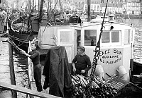 0149993 © Granger - Historical Picture ArchiveLE PORT D'AUDIERNE IN BRETAGNE.   trawler in Audierne harbour in Brittany (France) c. 1965. Full credit: AGIP - Rue des Archives / Granger, NYC -- All rights reserved.