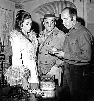 0150197 © Granger - Historical Picture ArchiveLE RAPACE.   Jose Giovanni (d) with Rosa Furman and Lino Ventura on set of film Birds of Prey january 6, 1968. Full credit: AGIP - Rue des Archives / Granger, NYC -- All rights res