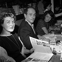 0150392 © Granger - Historical Picture ArchiveLEO FERRE.   singer Leo Ferre with his 2nd wife Madeleine Rabereau (r) at National Writers Committee meeting february 11, 1961. Full credit: AGIP - Rue des Archives / Granger, NYC -- All Rights Reserved.