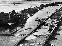 0150587 © Granger - Historical Picture ArchiveLES CONSEQUENCES DU TSUNAMI IN INDE, 1964.   Remains of the train carried by the cyclone and the tidal wave which fell down on the islands of Rameswaran and Dhanashodi, in the area of Madras, in India, on december 23rd 1964, photographied on January 1st, 1965. Full credit: AGIP - Rue des Archives / Granger, NYC -- All rights reserved.