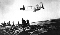 0150614 © Granger - Historical Picture ArchiveLES ESSAIS OF FRERES WRIGHT.   Orville Wright making a record gliding flight of 9-3/4 minutes on October 24, 1911 aboard the Wright Flyer (biplane of the brothers Wilbur and Orville Wright) here on the beach of Kill Devil Hills at Kitty Hawk, California 1911. Full credit: AGIP - Rue des Archives / Granger, NYC -- All Rights Reserved.
