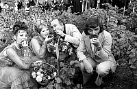 0150636 © Granger - Historical Picture ArchiveLES FRERES ENNEMIS.   french comics Les Freres Ennemis (Andre Gaillard left and Teddy Vrignault right) with two French Cancan dancers eating grapes during Grape Harvest fair in Montmartre, Paris october 06, 1973. Full credit: AGIP - Rue des Archives / Granger, NYC -- All rights reserved.