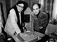 0150654 © Granger - Historical Picture ArchiveLES FRERES TAVIANI.   Paolo (g) and Vittorio Taviani leaving their handprints hands prints in clay for Stars Alley at Cannes Film Festival may 15, 1987. Full credit: AGIP - Rue des Archives / Granger, NYC -- All rights reserved.