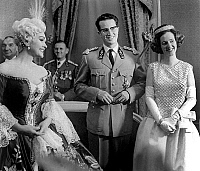 0150839 © Granger - Historical Picture ArchiveLES SOUVERAINS OF BELGIQUE AND ELISABETH SCHWARZKOPF.   King Baudouin 1st of belgium and queen Fabiola in Brussels with german soprano Elisabeth Schwarzkopf on december 20, 1962. Full credit: AGIP - Rue des Archives / Granger, NYC -- All ri.