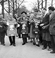 0151315 © Granger - Historical Picture ArchiveLOUIS OF FUNES.   actors Louis de Funes, Jean Marsac, Eddy Constantine distributing leaflets for show in Paris november 20, 1957. Full credit: AGIP - Rue des Archives / Granger, NYC -- All Rights Reserved.