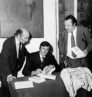 0151399 © Granger - Historical Picture ArchiveLOUIS NUCERA.   french writer Louis Nucera signing his first novel L' Obstine to french humorists Raymond Devos (r) and Teddy Vrignault member of the band Freres Ennemis june 17, 1970. Full credit: AGIP - Rue des Archives / Granger, NYC -- All Rights Reserved.