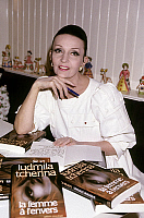 0151568 © Granger - Historical Picture ArchiveLUDMILLA TCHERINA.   Dancer Ludmilla Tcherina dedicating her book La Femme A l'Envers at home, Paris, october 16, 1986. Full credit: AGIP - Rue des Archives / Granger, NYC -- All Rights Reserved.